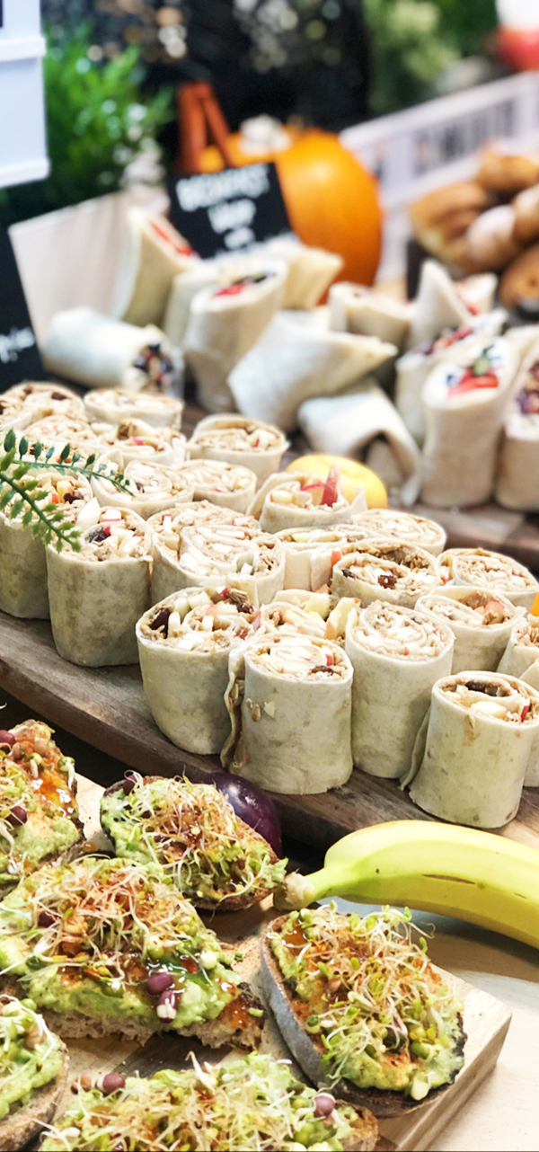 catering spread with wraps and avocado toast