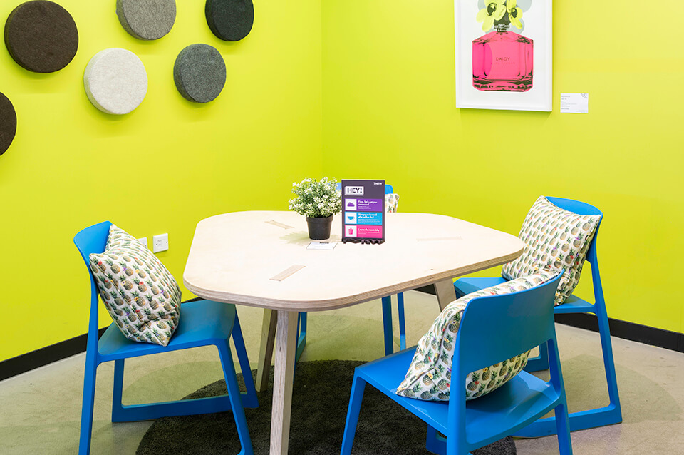 bright green meeting room with three seats