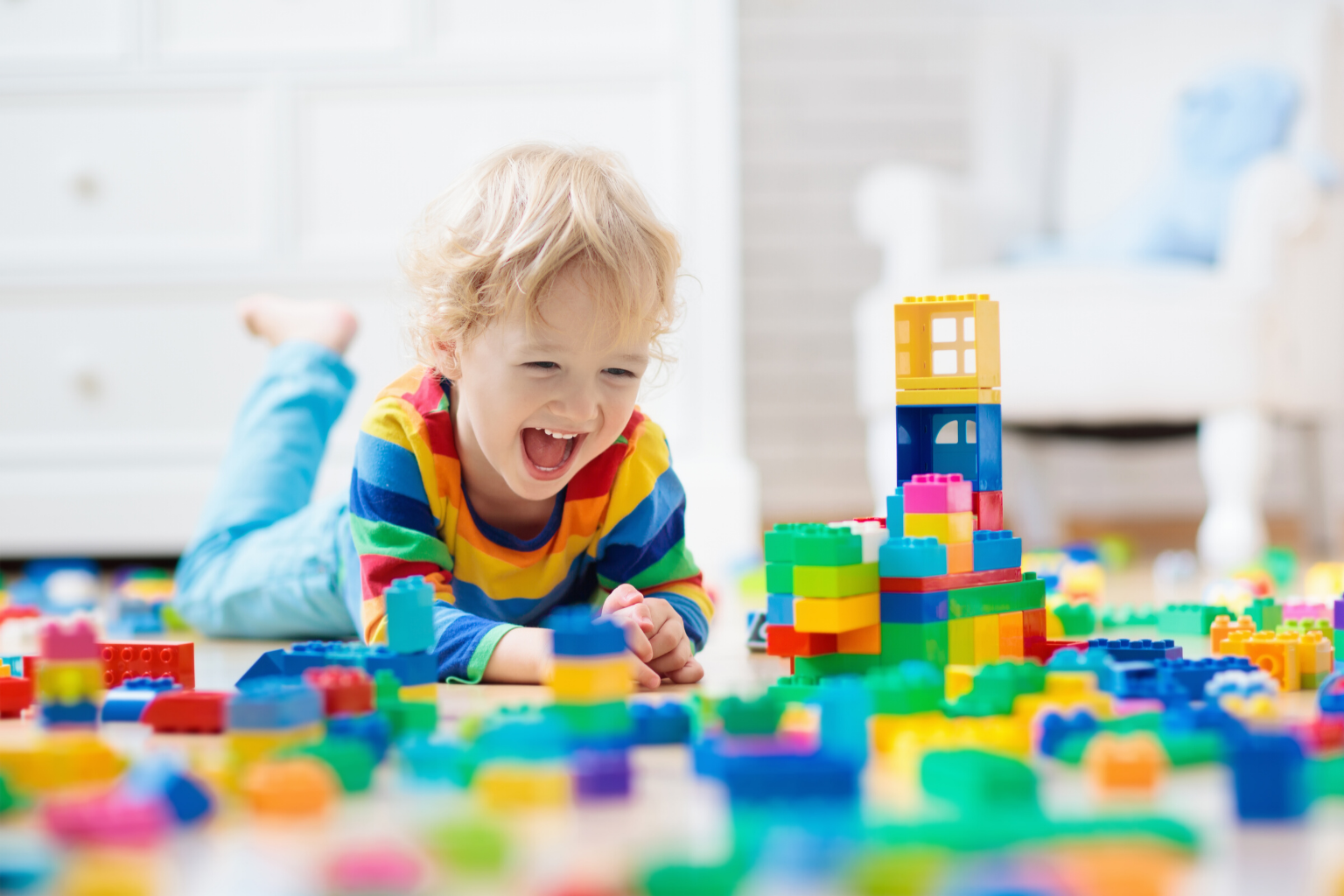 toddler playing with educational toy building blocks