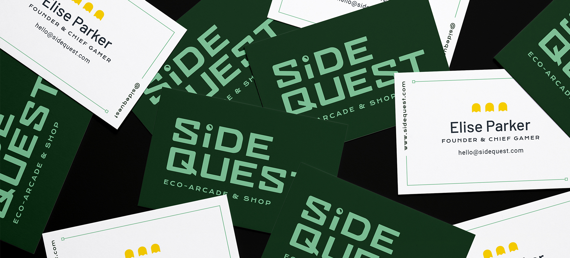 A pile of business cards for Side Quest