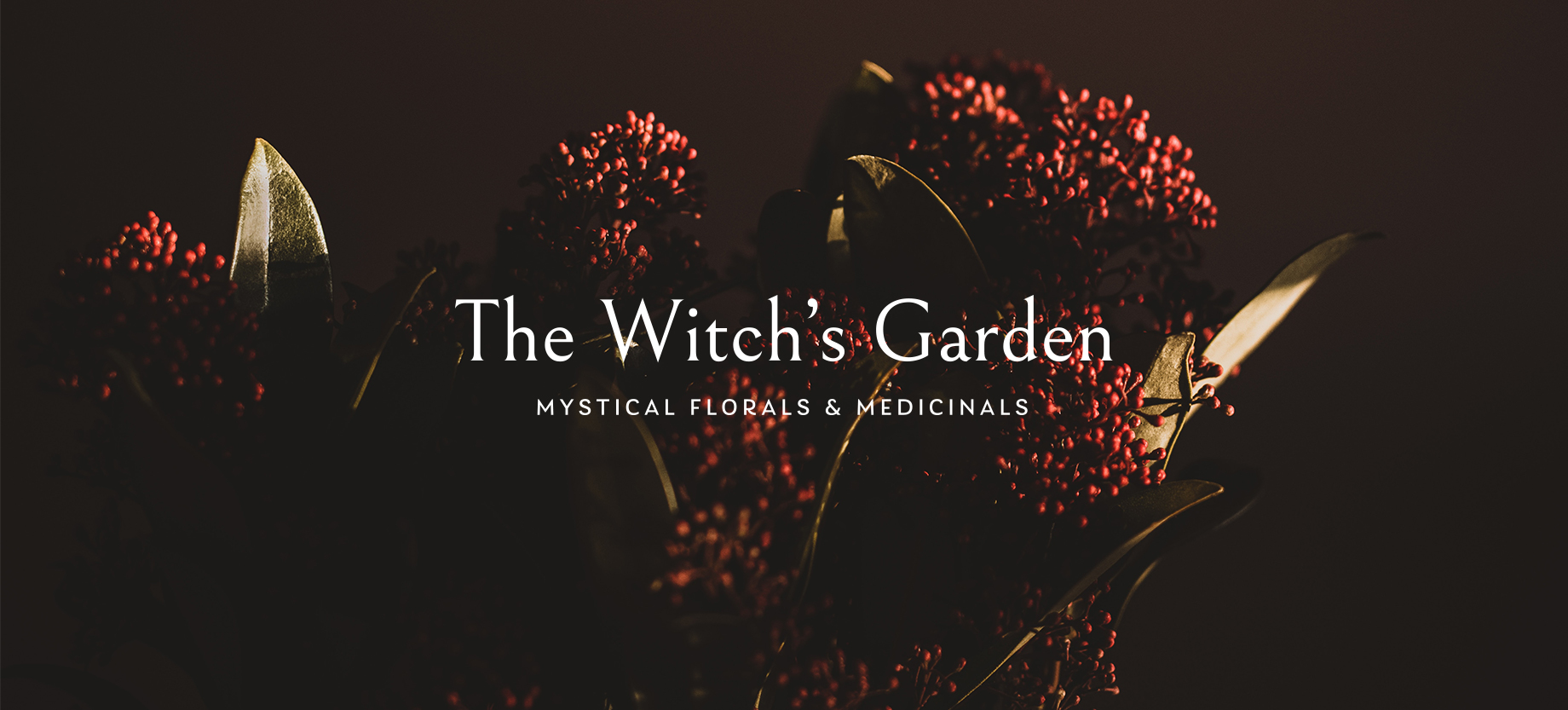 Dark florals with The Witch's Garden logo