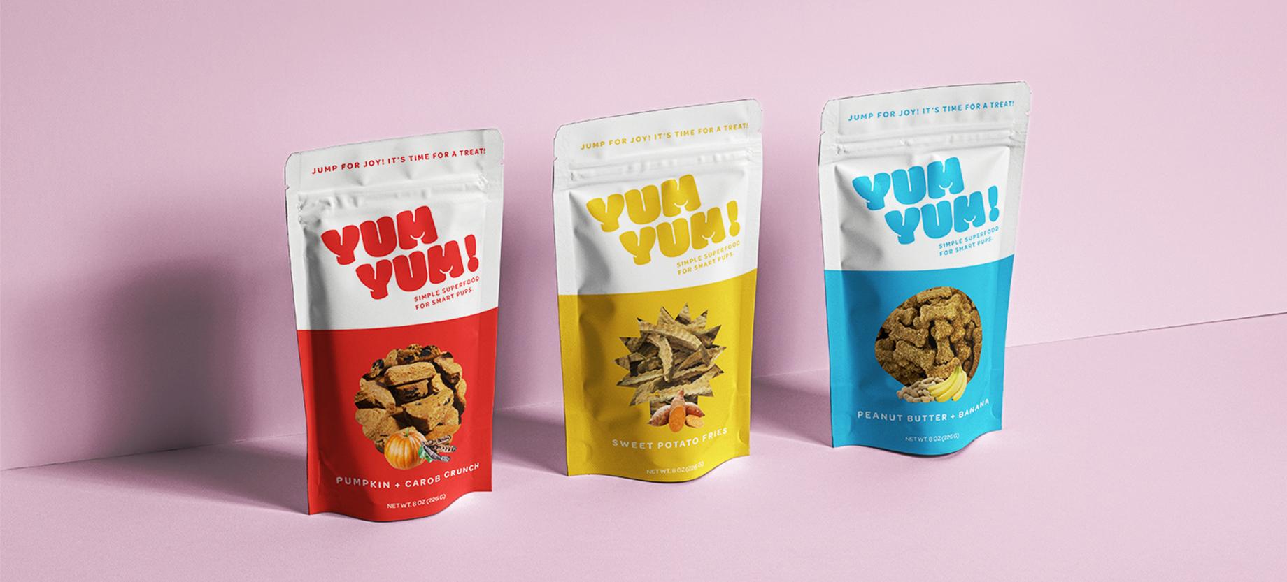 A row of Yum Yum! Dog treats packaging