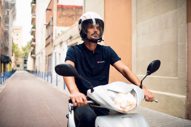 gig economy worker on a scooter