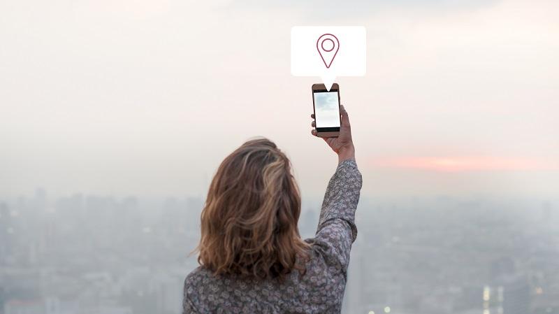 woman sharing her location via smartphone