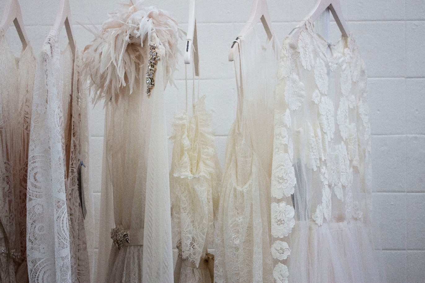 A rack with many differently cut dresses.