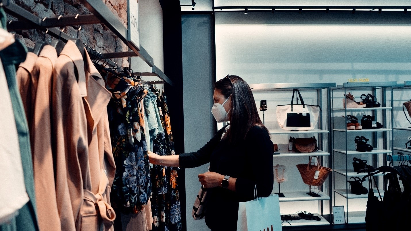 A woman shopping at a women's wear brand.