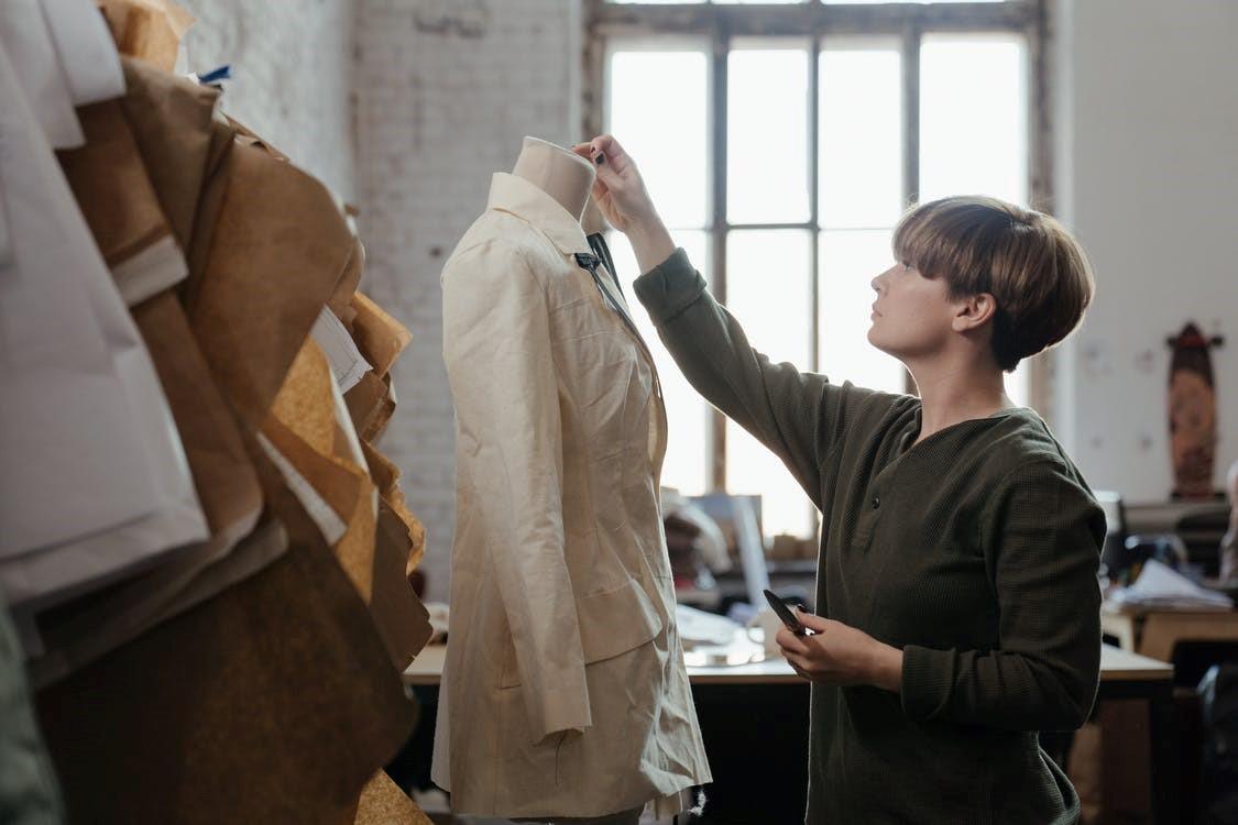 A garment manufacturer in her studio