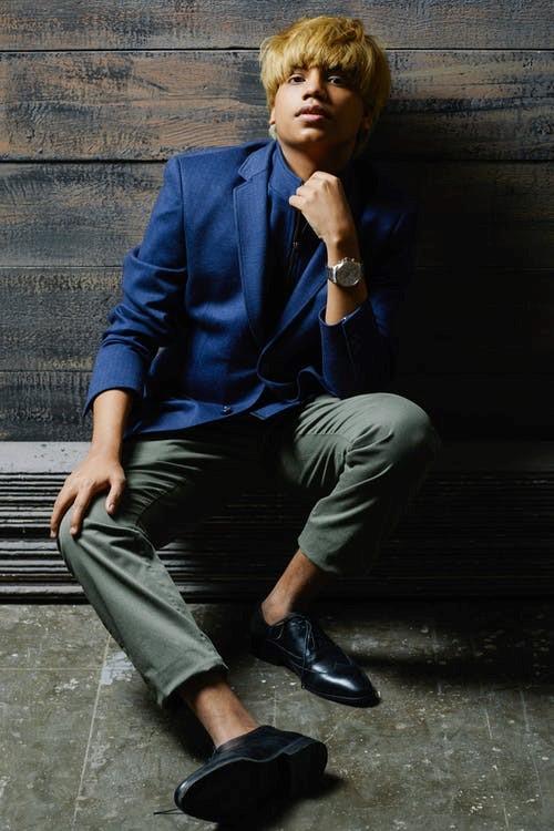Man Wearing A Blue Coat and Calf-length Chinos