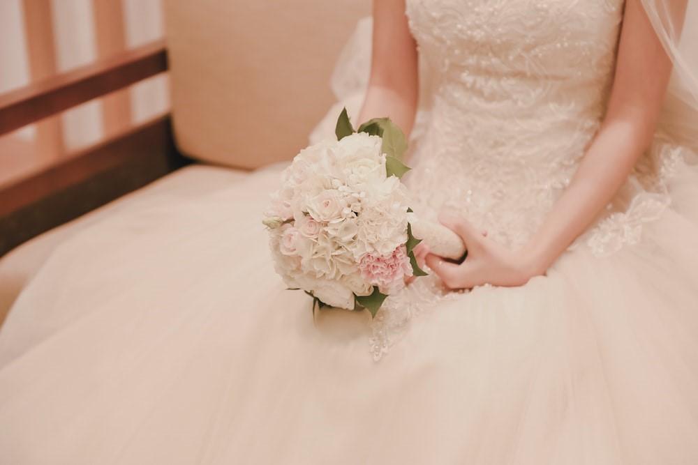 Bride wearing a custom made wedding gown.