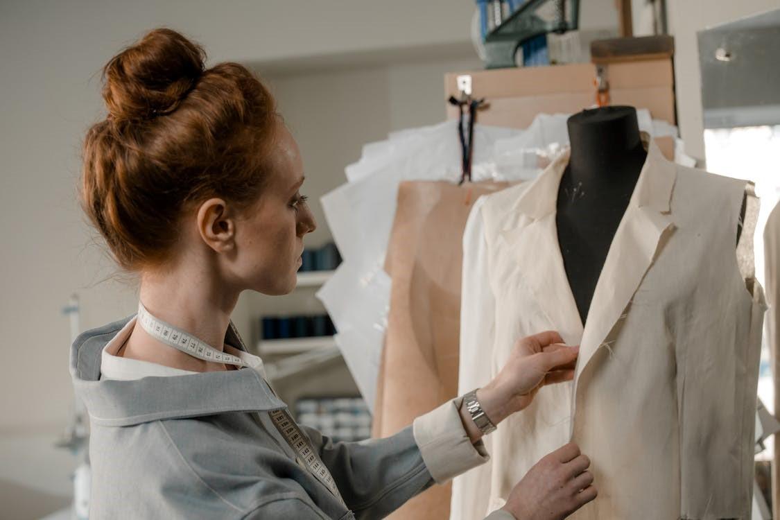 Fashion designer busy in garment sample making