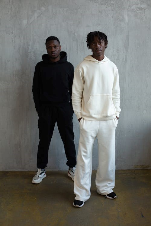 Two models wearing baggy clothing