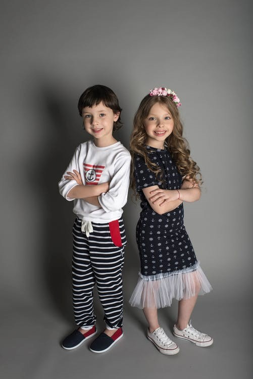a girl and a boy wearing fashionable clothes