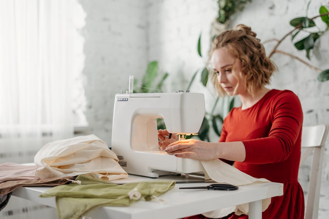 a cloth manufacturer sewing clothes