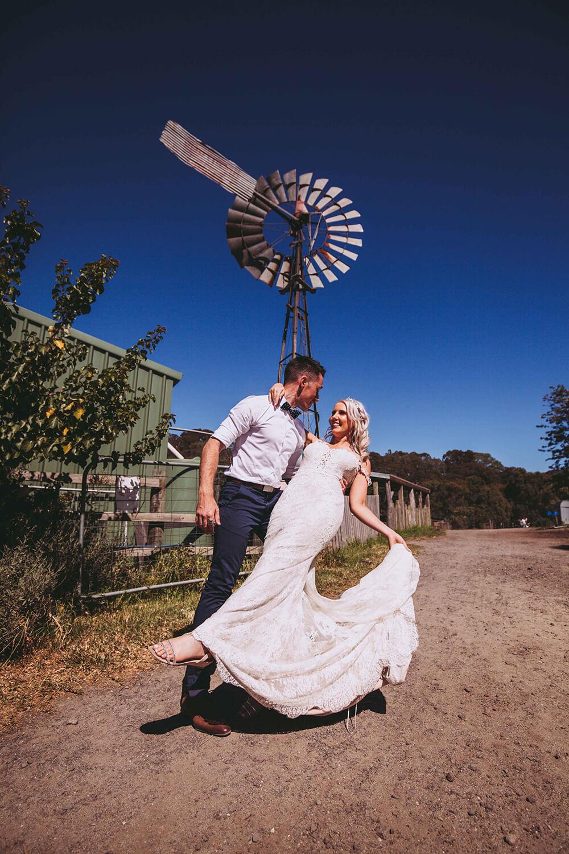 outback wedding, groom holding bride