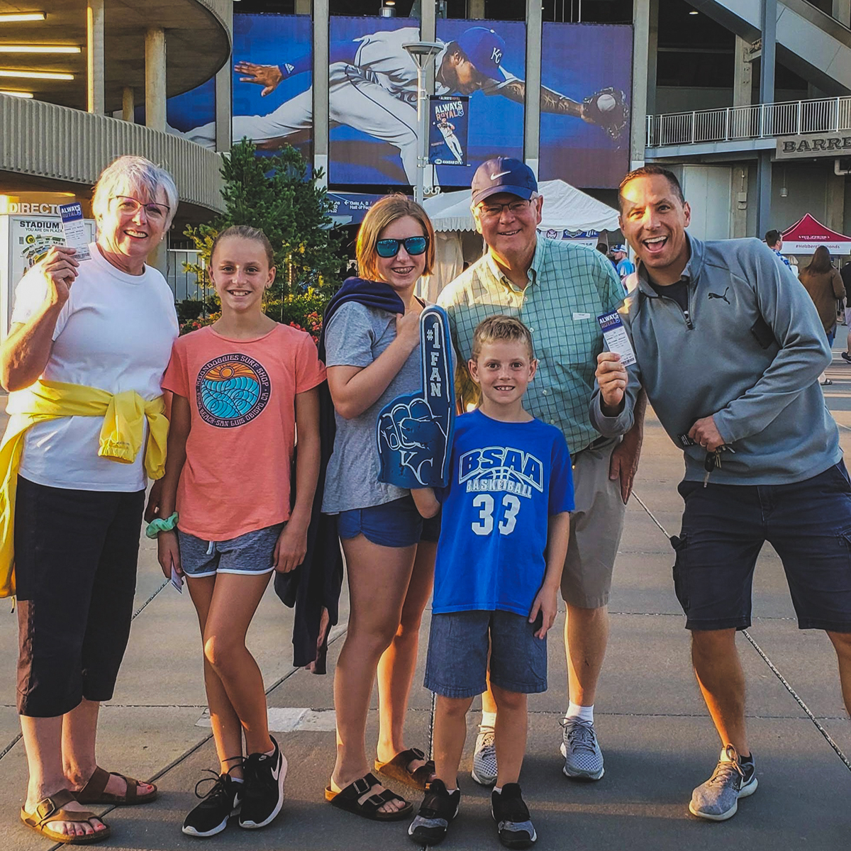 Dr. Blackburn, owner and lead orthodontist,  with his family at a Kansas City Royals game.