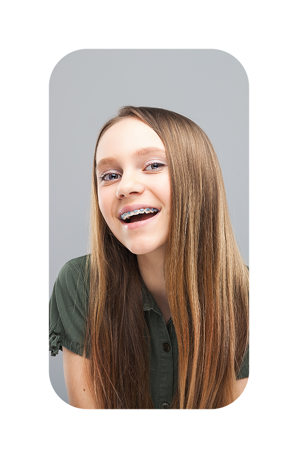 A photo of how happy you can be with color braces from the best orthodontist in Independence, Missouri.
