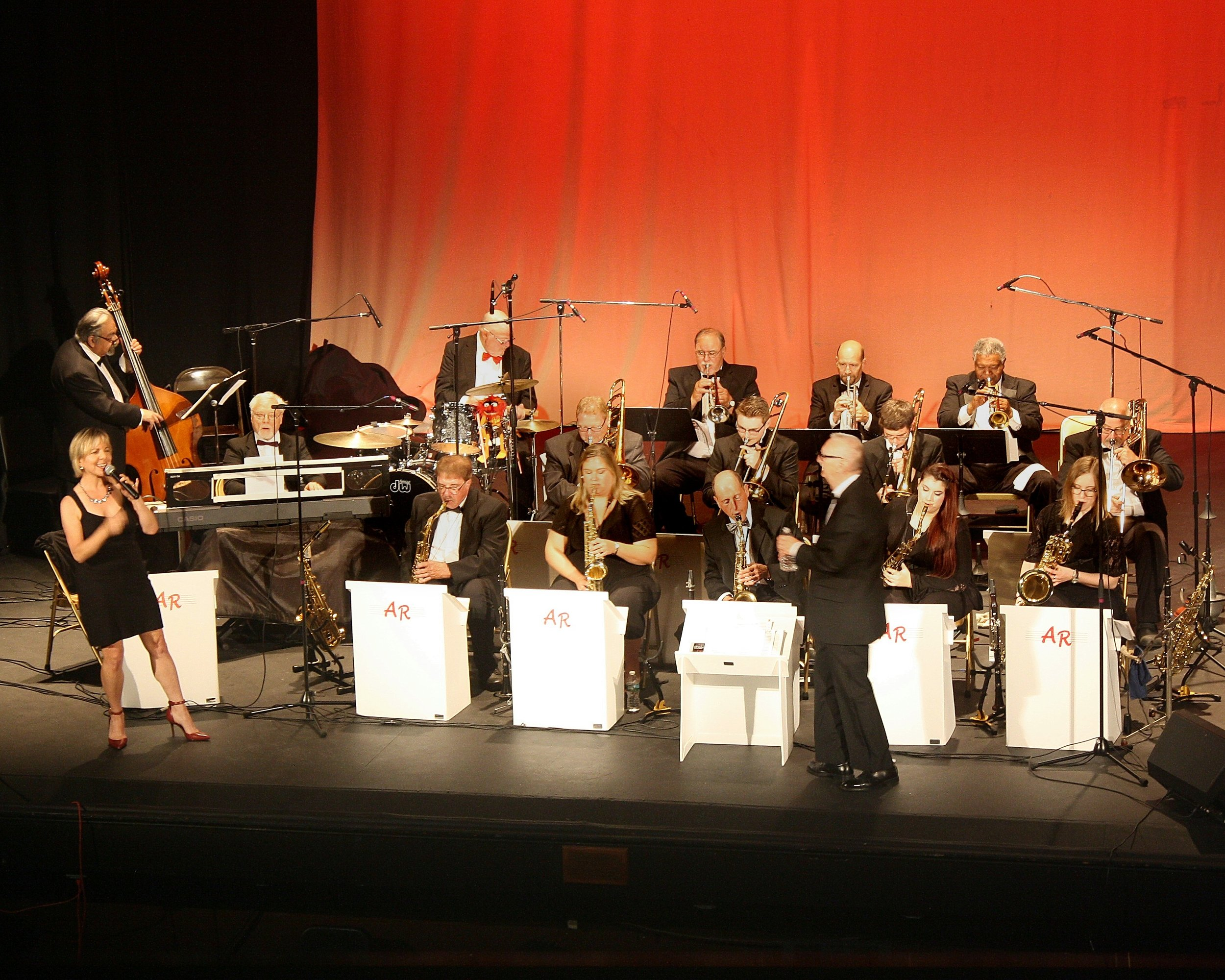 Big band performing in concert.