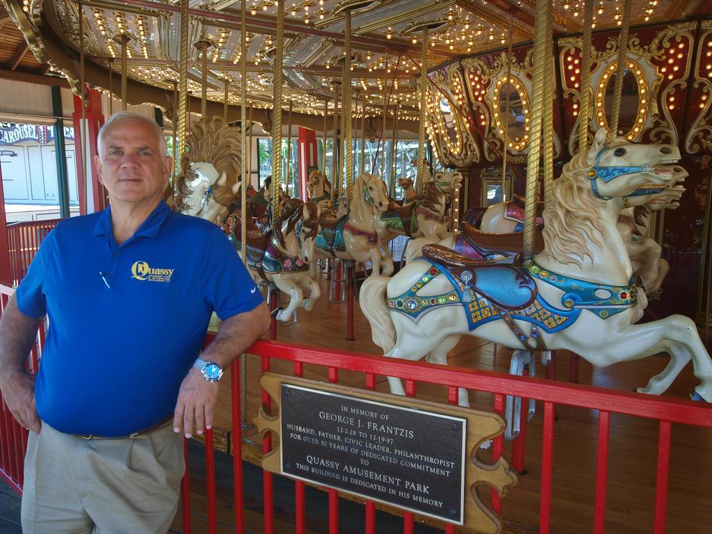 Gentleman standing in front of carousel