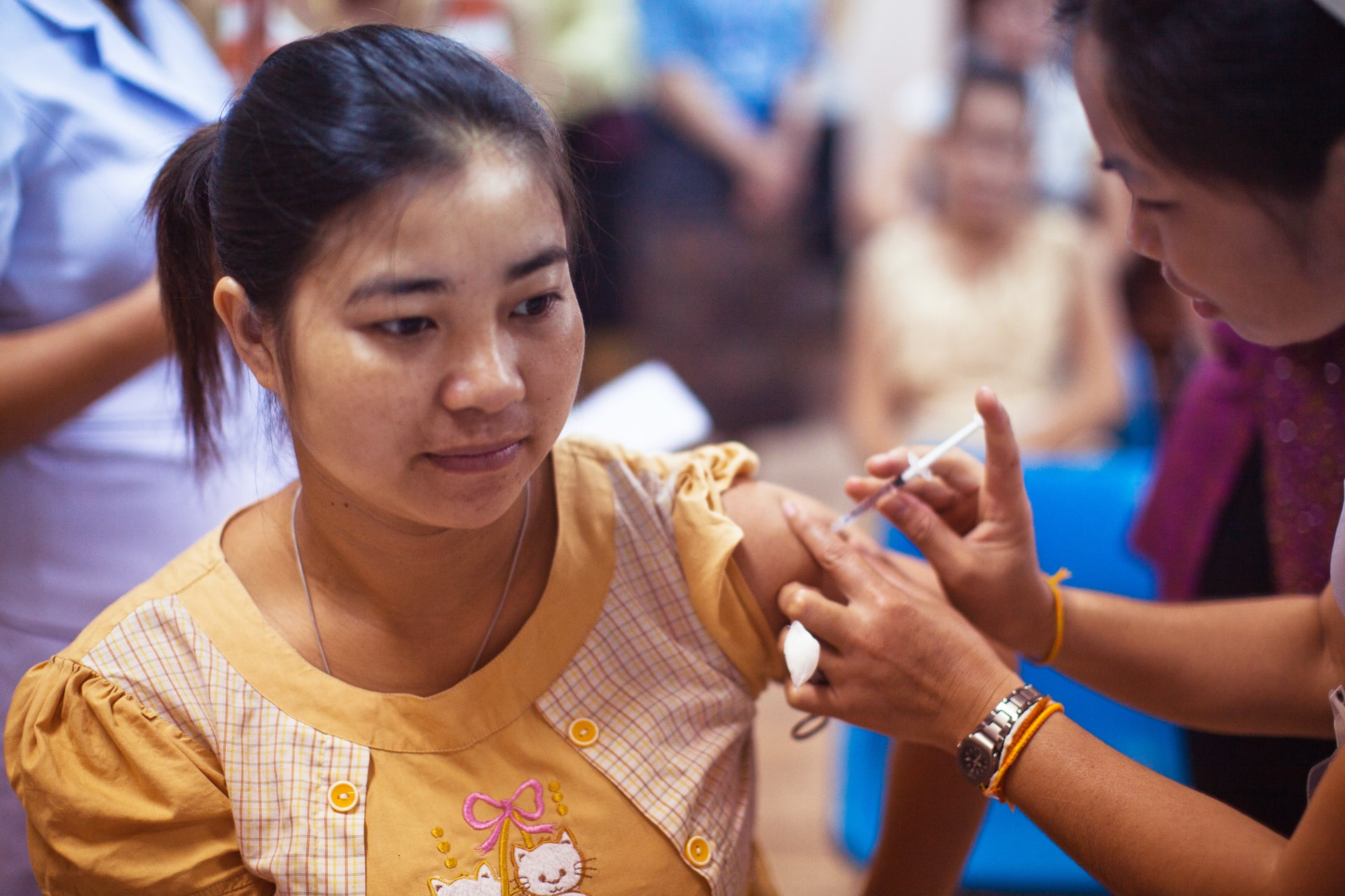 Asian woman receives a Covid Vaccine