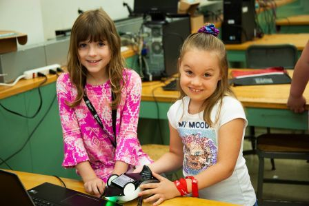Two young girls working on a science project at NIU STEAM Camp