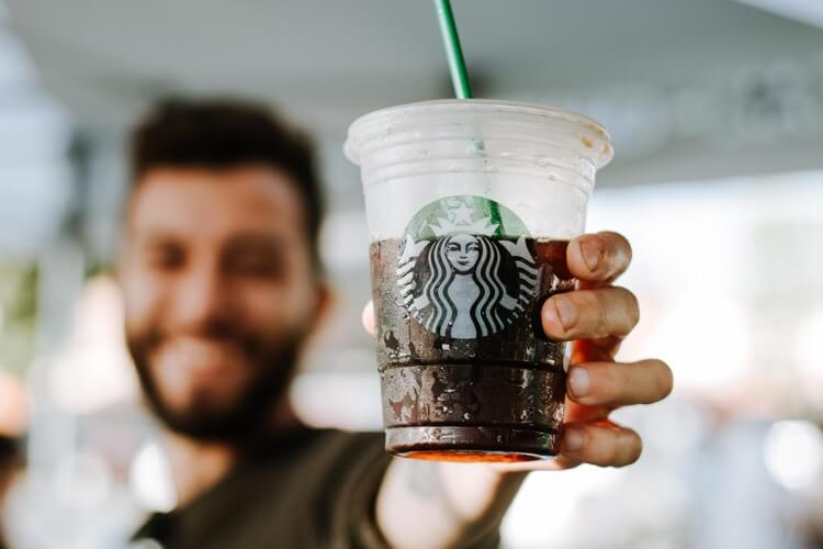 Man holding free Starbucks coffee