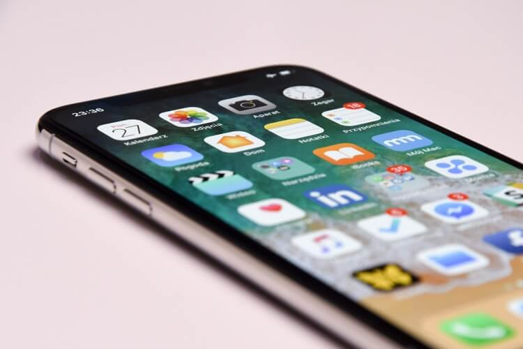 Close-up of an iPhone and several apps on the home screen