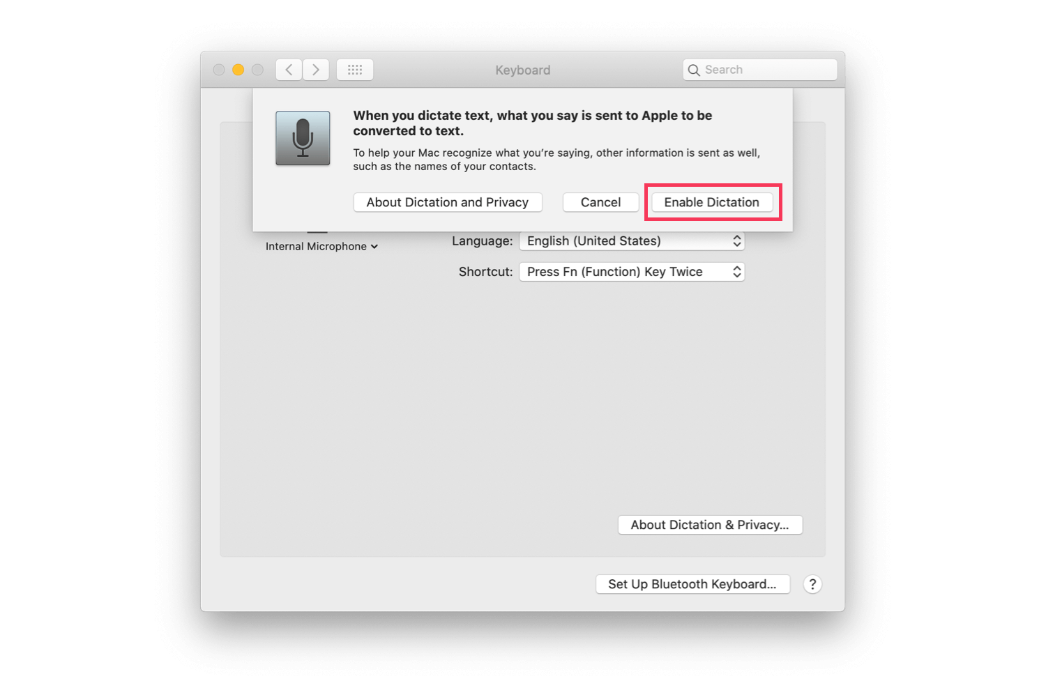 The macOS System Preferences' screen with Enable Dictation highlighted