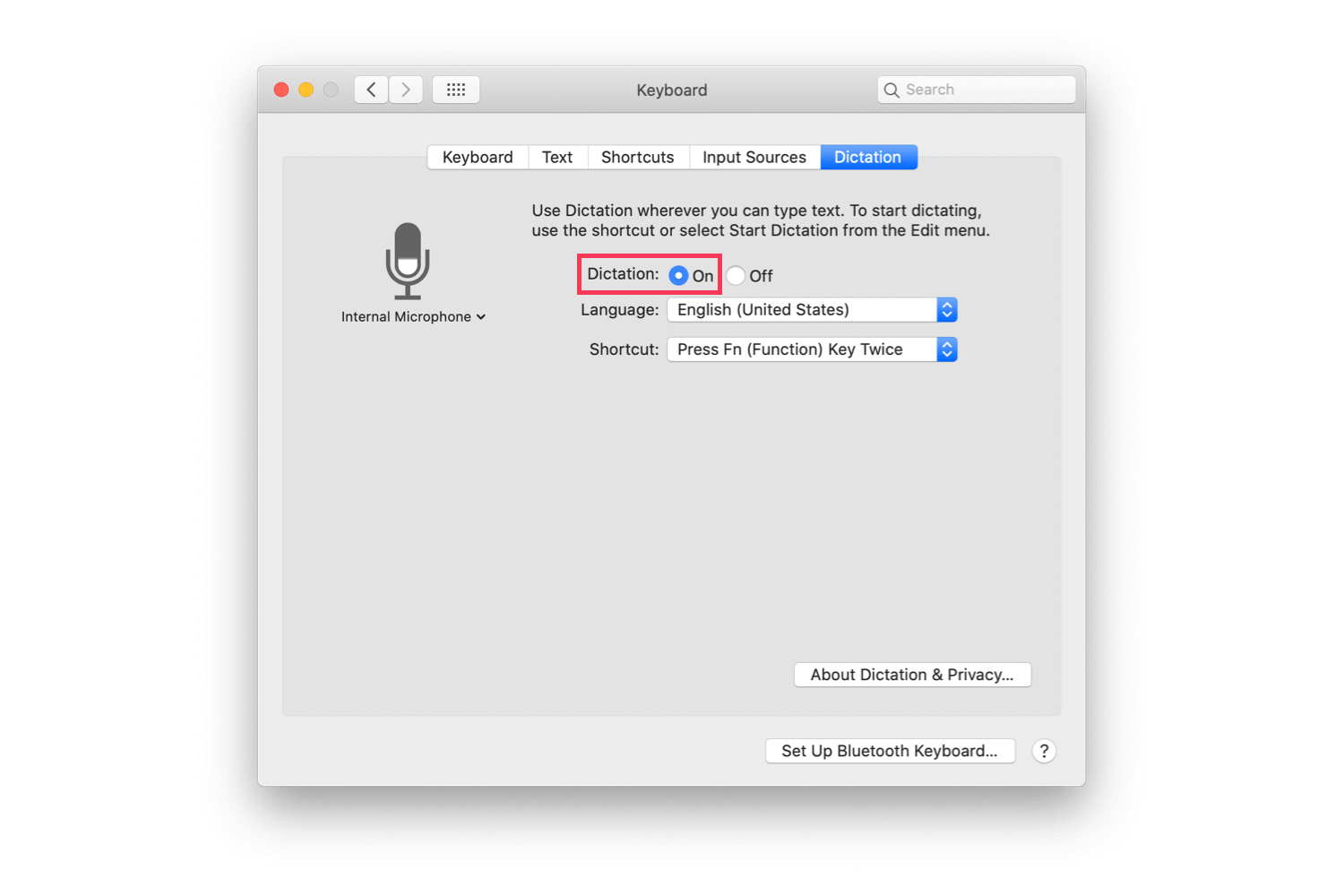 The macOS System Preferences' screen with Dictation > On highlighted