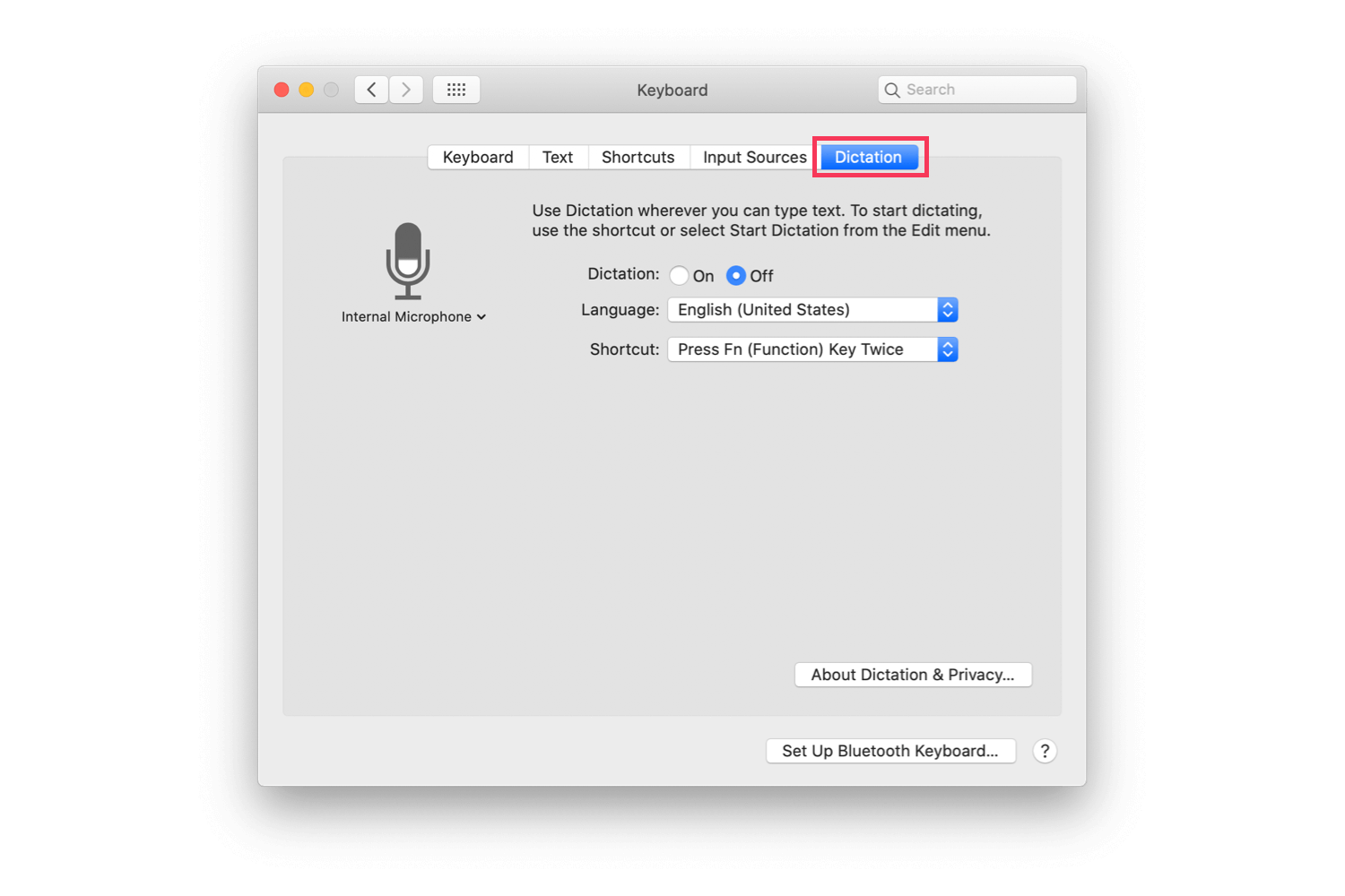The macOS System Preferences' screen with Dictation highlighted