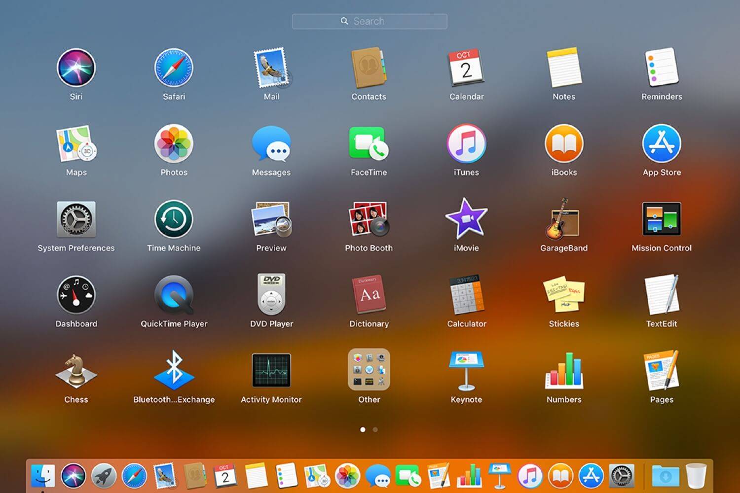 Launchpad on macOS, showcasing a grid of applications, including the Dictionary app.