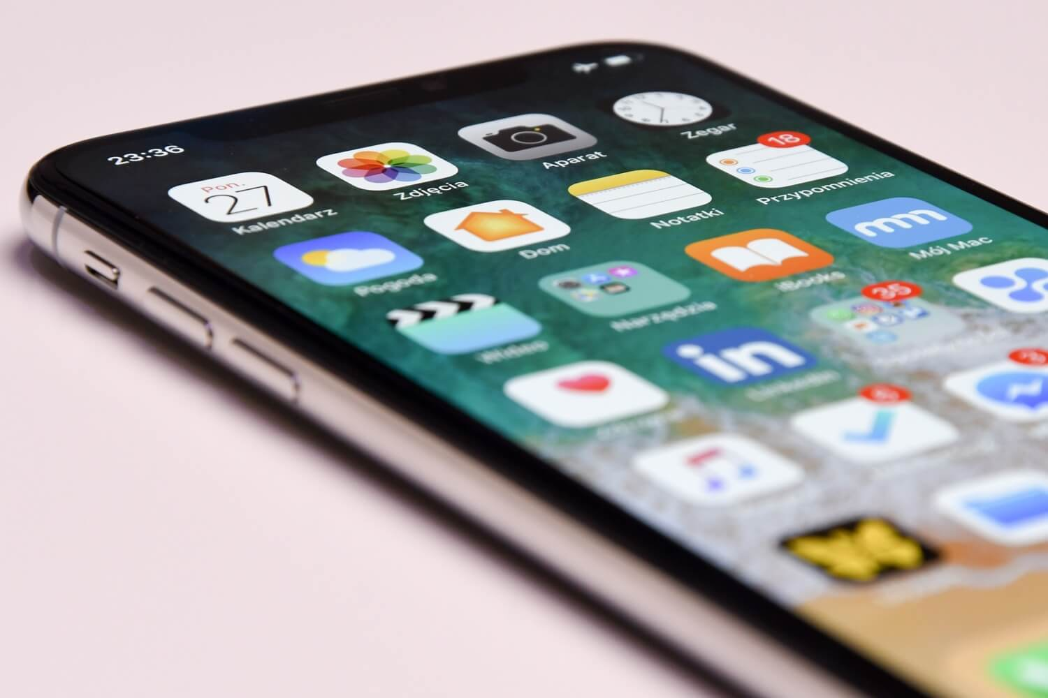 Close-up of an iPhone and several apps on the home screen.
