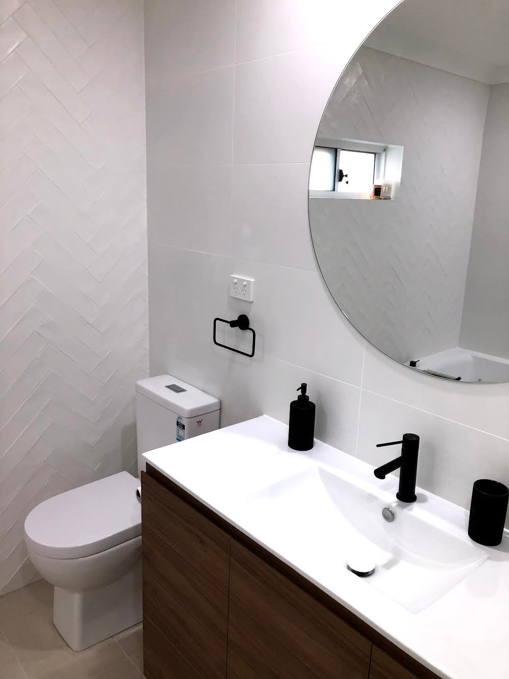 picture of bathroom with herringbone wall tiles