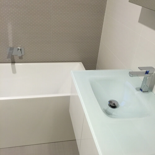 picture of bathroom with square free standing bath
