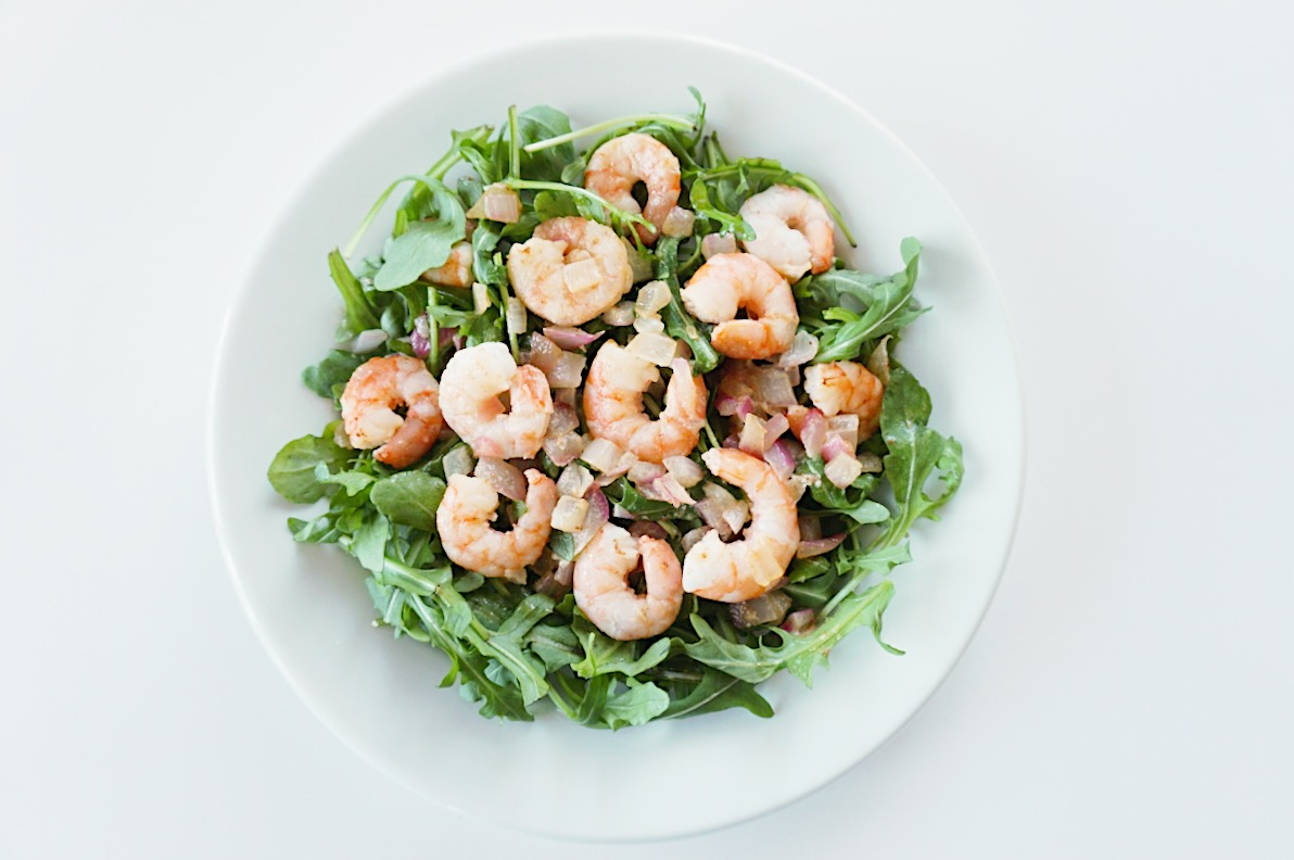 Cooked prawns and salad in a white bowl