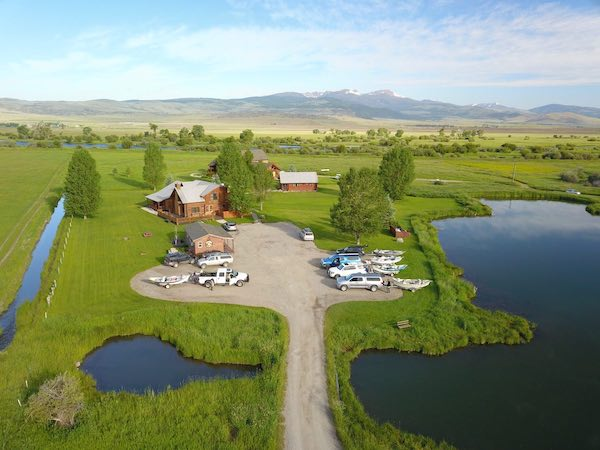 Drone shot of the Madison Valley ranch with river in the background.