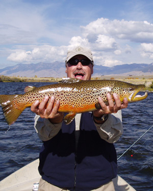 Scott carver with a big brown trout