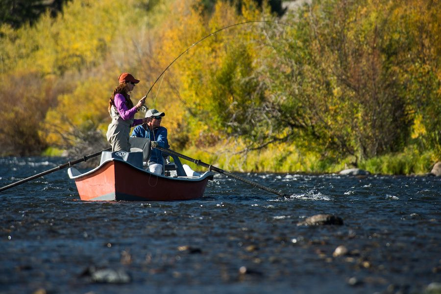 Fly fishing guide Rob Kessler rowing a drift boat on the Madison.