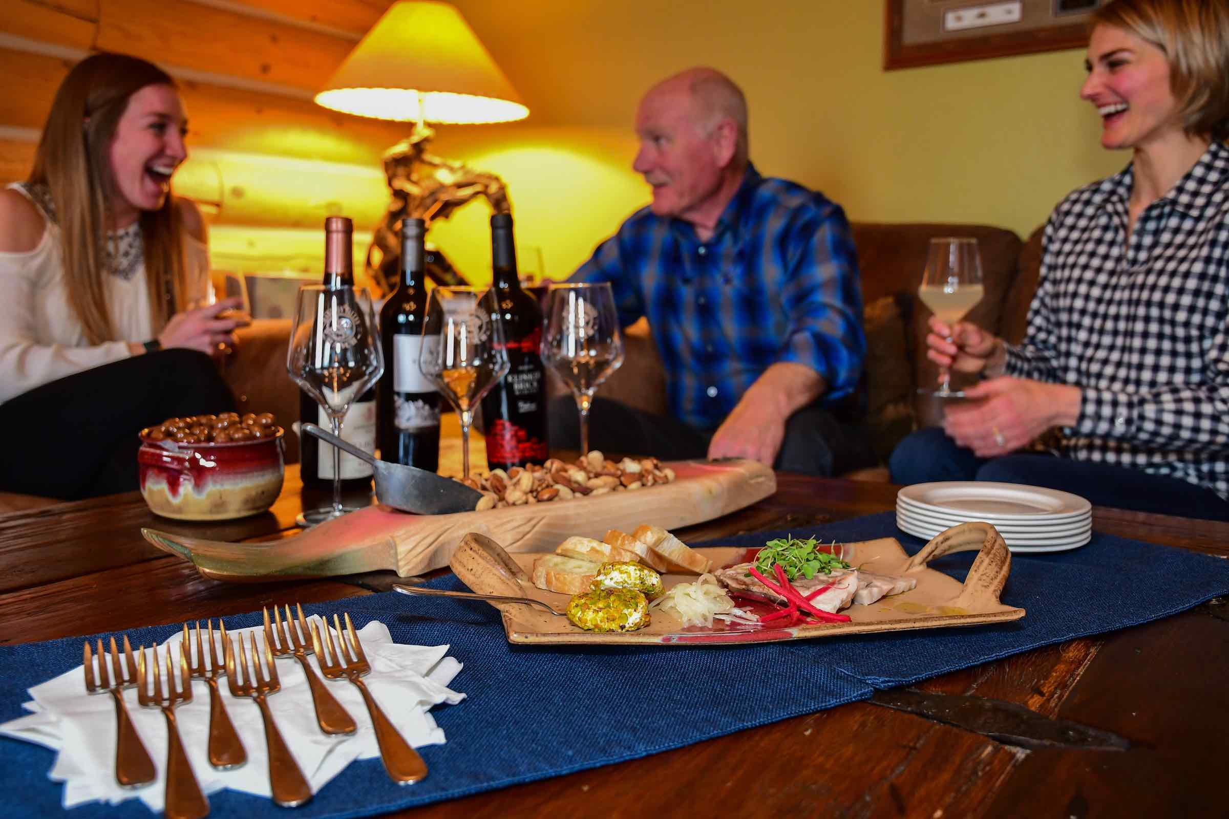 Guests enjoying appetizers before dinner at Madison Valley Ranch restaurant in Ennis, Montana.