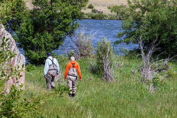 Dave Evans, fly fishing guide, walking to the river.