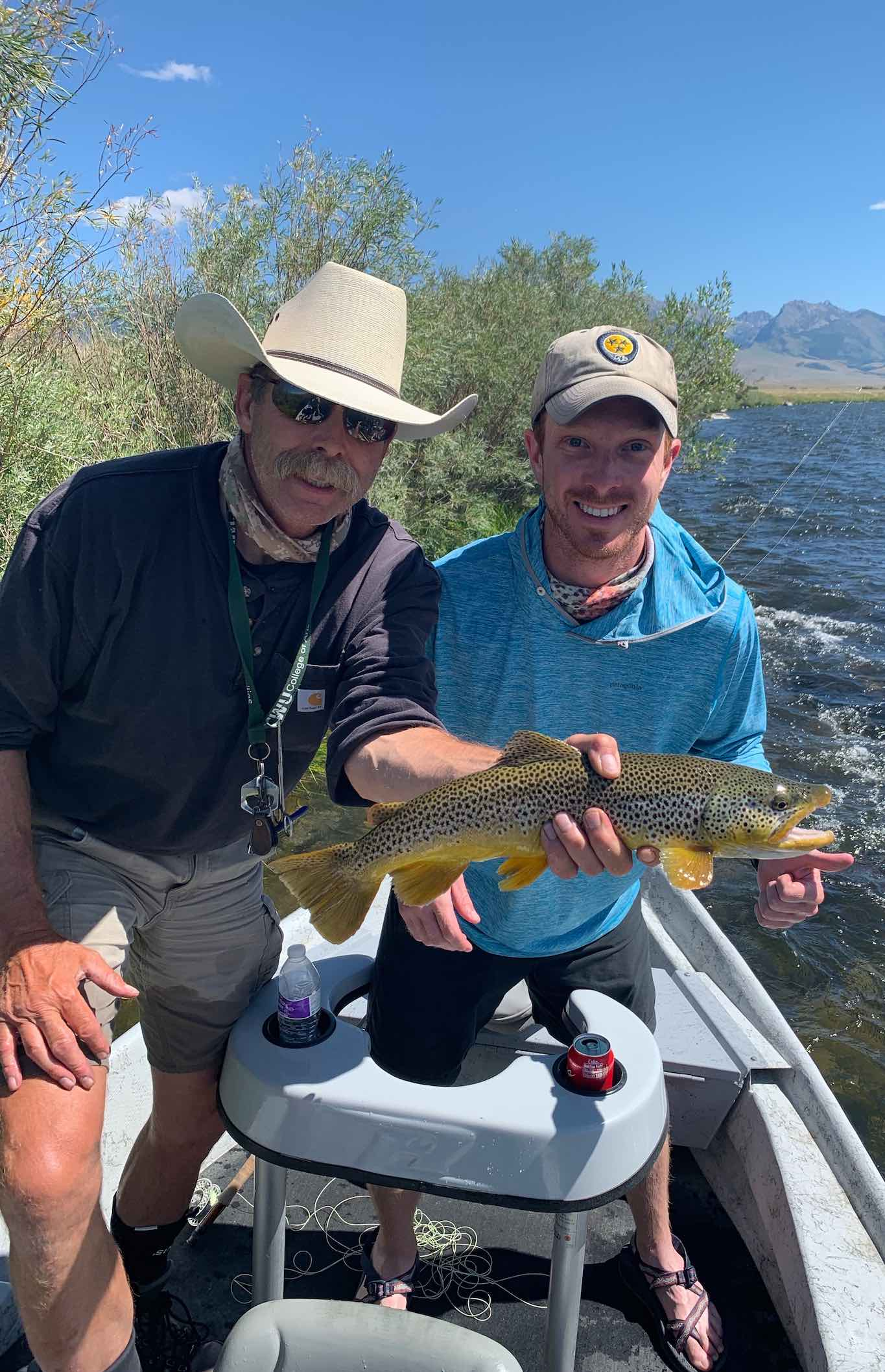 Fly Fishing Guide Chris Eaton holding a Madison River brown trout.