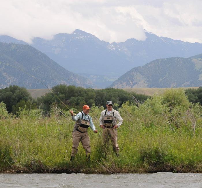 Montana anglers standing on the madison river.