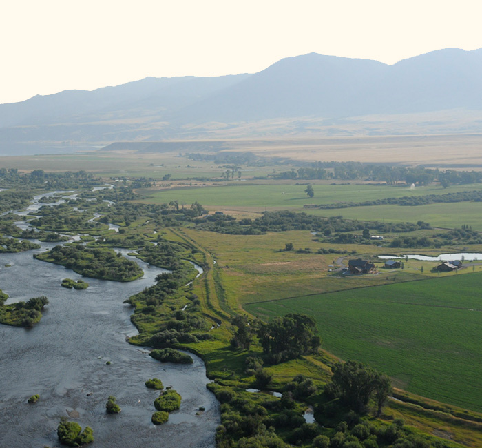Aerial shot showing Madison River next to Madison Valley Ranch.