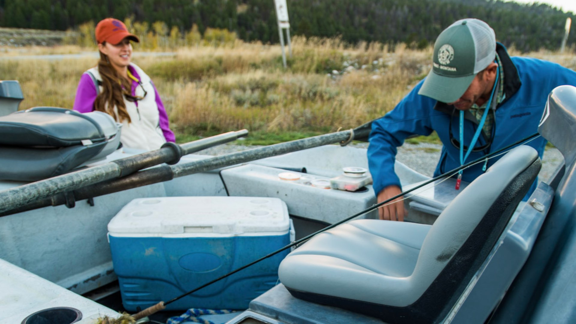 A fly fishing guide in his drift boat.