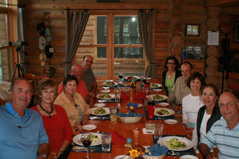 Guests around the dinner table at Madison Valley Ranch.