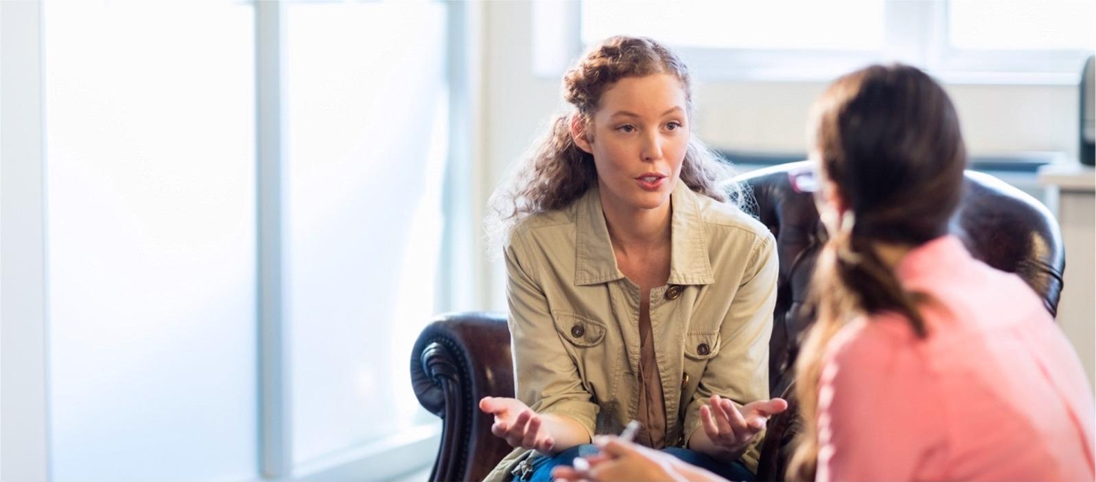 Two woman talking