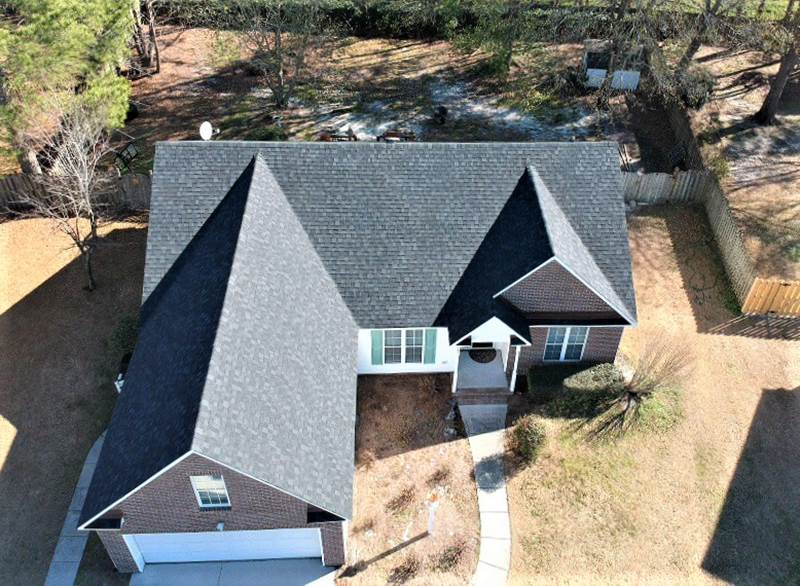 Drone picture after roof replacement on a brick house. Manufacture: IKO, Series:Cambridge Color:dual black.