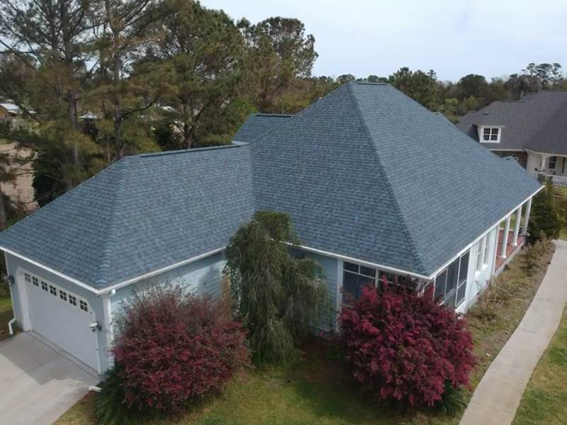 Steep hip roof after asphalt shingle roof replacement. Manufacture: CertainTeed Series: Landmark, Color:Atlantic blue.