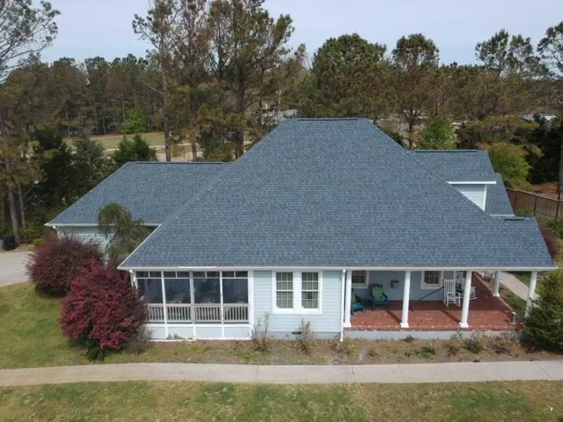 Top view of 2 story house. New asphalt roof installed. Manufacture: Certainteed, Series: Landmark , Color: Atlantic Blue.
