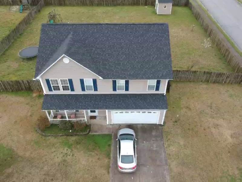 Top view of 2 story house. New asphalt roof installed. Manufacture: Certainteed, Series: Landmark , Color: Charcoal Black.