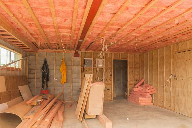 Room remodeling with open stud bay, pink fiberglass insulation been used for walls and ceiling